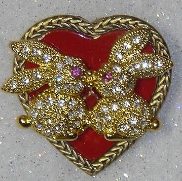 http://www.bunnyrabbit.com/jewelry/pinsbyKen/HeartKissBunnies.jpg